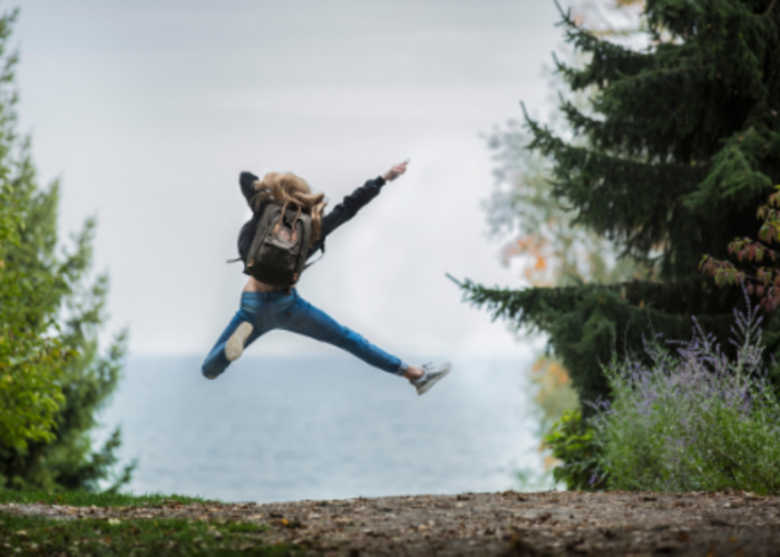 Excited person jumping 1920 x 1080